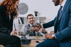 3 предпринимателя имея встречу Стоковые Изображения RF