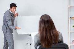 Представление дела в офисе с человеком и женщиной Стоковые Фотографии RF