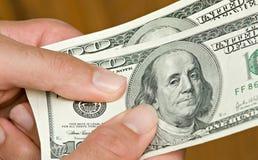 представляет счет руки доллара Стоковое Изображение RF