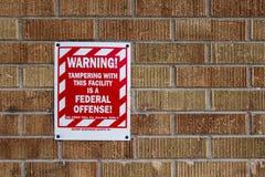 Предупредительный знак федеральной обиды стоковые изображения