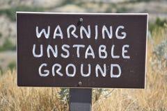Предупреждающая неустойчивая земля Стоковые Фото