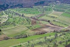 Предыдущая весна fields высоко-угол сельской местности Стоковое Изображение