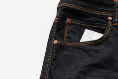 Презерватив в джинсах pocket с первым слова safty Стоковые Изображения RF