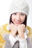 Прелестно сторона усмешки маленькой девочки в свитере Стоковое Изображение RF