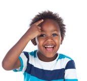 Прелестный afroamerican думать ребенка стоковые фото