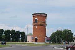 Преобразованная водонапорная башня красного кирпича Стоковые Фотографии RF