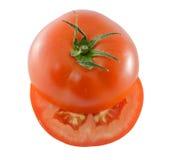 Прерванный томат изолированный на белой предпосылке Стоковое Изображение RF