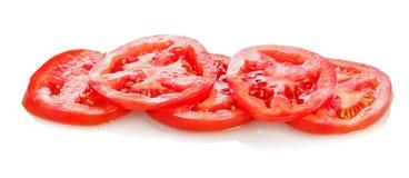 Прерванный томат на белой предпосылке Стоковое Изображение RF