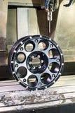Прессформа оправы черноты сплава автомобиля новая в филировать и машине токарного станка Стоковые Фотографии RF