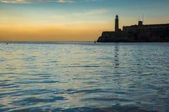 Преследуйте с замком El Morro в Гаване, Кубе Стоковое фото RF