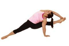 Предварительный женский модельный инструктор йоги в обезьяне s Visvamitrasana Стоковая Фотография