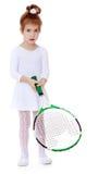 Прелестная маленькая девочка с ракеткой тенниса в руке Стоковые Изображения
