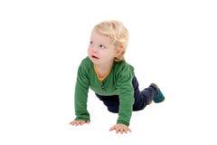 Прелестный белокурый вползать младенца Стоковые Изображения RF