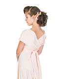 Предназначенная для подростков девушка в розовом платье Стоковая Фотография RF