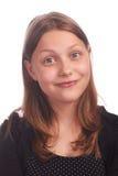 Предназначенная для подростков девушка делая смешные стороны на белой предпосылке Стоковая Фотография