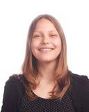 Предназначенная для подростков девушка делая смешные стороны на белой предпосылке Стоковое Фото