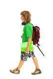 Предназначенный для подростков мальчик идя к школе стоковое изображение