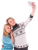2 предназначенных для подростков девушки делают selfie на белой предпосылке Стоковая Фотография RF