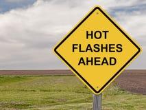 Предосторежение - горячие вспышки вперед стоковое изображение