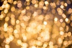 Предпосылка конспекта золота Bokeh defocused Стоковая Фотография