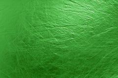 предпосылка яркая - зеленое текстурированное металлическое Стоковая Фотография