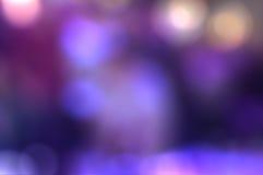 Предпосылка абстрактной нерезкости фиолетовая светлая Стоковые Изображения RF