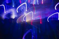 Предпосылка лазера покрасила лучи в игре, где все shootin Стоковые Фотографии RF