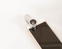Предпосылка белизны мобильного телефона макроса Fisheye установленная Стоковое Фото