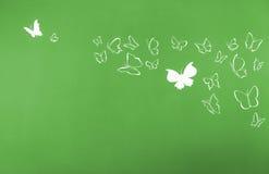 Предпосылка белизны silhouettes летать бабочек Стоковые Фото