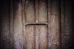 Предпосылка двери низкого основного освещения старая, старый свет двери и тень Стоковое фото RF