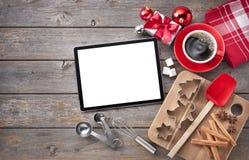Предпосылка выпечки таблетки рождества стоковые изображения