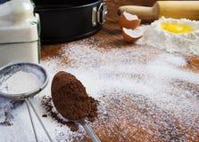 Предпосылка выпечки - яичко, мука, сахар, какао Космос для текста Стоковое Изображение