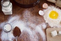 Предпосылка выпечки - яичко, мука, сахар, масло, какао Стоковые Изображения RF