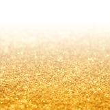 Предпосылка градиента яркого блеска золота Стоковые Фото