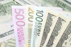 Предпосылка евро и долларовых банкнот фокус отмелый Стоковое фото RF
