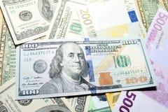 Предпосылка евро и долларовых банкнот фокус отмелый Стоковая Фотография