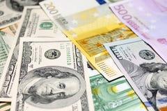 Предпосылка евро и долларовых банкнот фокус отмелый Стоковые Изображения RF
