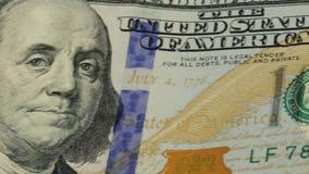 предпосылка денег наличных денег Вращан портрет Бенджамина Франклина на конце счета доллара США 100 вверх, изображение видеоматериал