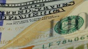 предпосылка денег наличных денег Вращан портрет Бенджамина Франклина на конце счета доллара США 100 вверх, изображение акции видеоматериалы