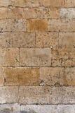 Предпосылка детали старого крупного плана каменной стены архитектурноакустическая стоковые фото