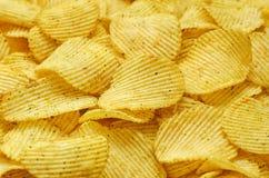 Предпосылка еды картофельных стружек стоковые фото