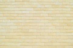 Предпосылка желтых кирпичей Стена желтых кирпичей кирпич разбил белизна стены текстуры гипсолита Стоковые Фото