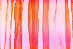 Предпосылка занавеса маркизета оранжевая розовая Стоковые Изображения RF