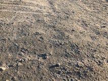Предпосылка земли песка камешка Стоковые Изображения