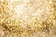 Предпосылка золотых светов с влиянием bokeh Стоковая Фотография