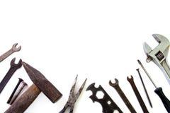 Предпосылка инструментов здания над белизной стоковое изображение