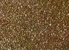 Предпосылка искры яркого блеска золота Стоковые Изображения RF