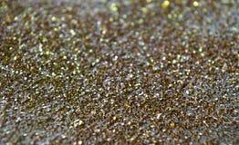 Предпосылка искры яркого блеска золота Стоковая Фотография RF