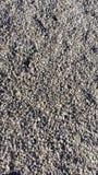 Предпосылка камней на пляже Стоковая Фотография