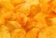 Предпосылка картофельной стружки, конец вверх Стоковые Фото